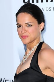 Michelle Rodriguez glammed up her look with a pair of massive diamond teardrop earrings when she attended the 2012 amfAR Gala.