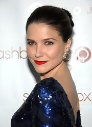Sophia Bush attended the Art of Elysium auction wearing a bold matte orange-red lipstick.