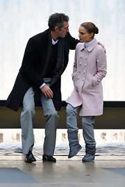 Natalie perfects pastels in winter, wearing a pink coat with her slate gray Uggs.