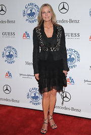 Bo Derek finished off her ensemble in sexy style with a pair of bejeweled black evening sandals.
