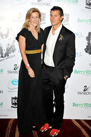 Bear Grylls looked oh-so-stylish in a sleek black suit, but the dragonfly pin and Union Jack loafers were a fun surprise.
