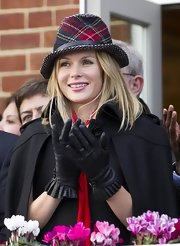 Amanda Holden applauded the action at the Hennessy Gold Cup in ladylike black leather gloves with ruffled cuffs.