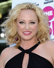 Virgina Madsen's blonde curls were thick and voluminous at the premiere of 'The Hot Flashes.'