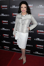 Joan wore a snakeskin leather jacket over a white snakeskin leather frock to 'The Kennedys' premiere.
