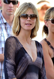 Heidi Klum showed off her square shades while hitting the merry-go-round with her family.