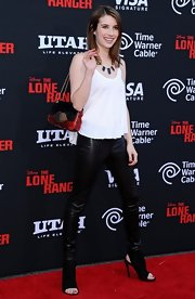 A multi-textured red and black chain-strap bag added color and flair to Emma Roberts' outfit at the 'Lone Ranger' premiere.
