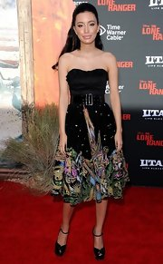 Christian Serratos was a charmer at the premiere of 'The Lone Ranger' in a strapless dress with a sweetheart neckline and a print skirt.