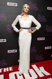 Tamsin Egerton chose a long-sleeve, white gown with a ruffled neckline for her elegant look at 'The Look of Love' premiere.