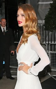 Rosie Huntington-Whiteley was oozing glamour at the Moet & Chandon Etoile Awards. To try her retro style, set dry hair in hot rollers. To relax the curls slightly, brush tresses with a natural bristle brush, then make a deep side part. Smooth the hair on the top of the head, tousle ends lightly and spritz with a flexible-hold hairspray.