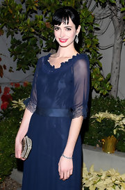 Krysten Ritter accented her ladylike sapphire dress with a beaded champagne clutch.