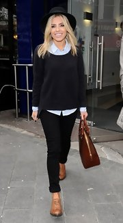 Mollie King paired a fitted sweatshirt over a classic button down for a more preppy look.