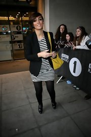 Frankie Sandford paired a classic black blazer with a striped dress for a cool mod-inspired look.