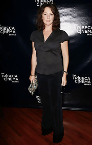 Talia Balsam posed at the Tribeca premiere of 'The Savages' wearing pinstriped shirt and a pair of wide-legged pants.
