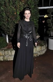 Juliette Binoche toughened her sheer black gown with a leather tie-waist vest.