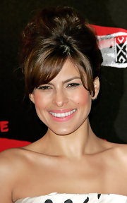 Eva loves her elegant updo's and she highlighted her flawless makeup and stunning smile with this bouffant style bun.