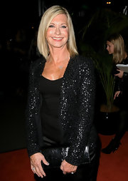 Olivia Newton-John sparkled wearing a sequined blazer at the Sydney opening of 'The Star.'