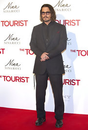 Johnny Depp looked polished in his gray suit at 'The Tourist' Madrid premeire.