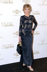 Jane Fonda teamed her sophisticated navy dress with champagne peep-toes.