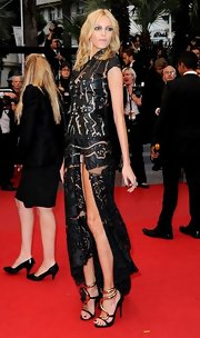 Anja Rubik strode the red carpet at the 'Therese Desqueyroux' premiere wearing a unique pair of heels featuring metallic gold snakes encircling her ankles.
