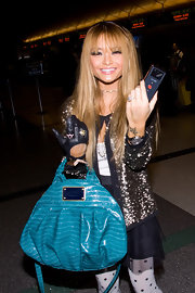 Tila executed a fashion homage to Michael Jackson with her one-gloved look. She chose a black biker glove and accessorized it with a couple girlie rings.