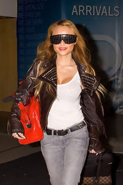 Can she see where she's going? Tila rocks serious stunner shades with her studded leather jacket.
