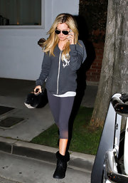 Ashley Tisdale kept things low-key in a pair of cropped ombre leggings.