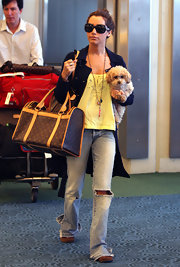 Oh the life of a pooch. It must be nice to travel in a luxury dog bag, Ashley never leaves home without her handy LV dog carrier.