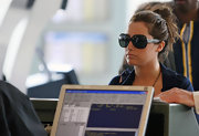 Ashley wore an oversized pair of black plastic sunglasses with silver-studded temples.