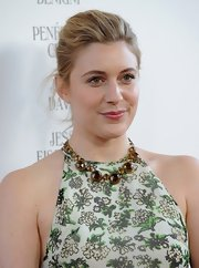 A lovely gemstone necklace infused some elegance into Greta Gerwig's breezy dress at the premiere of 'To Rome with Love.'