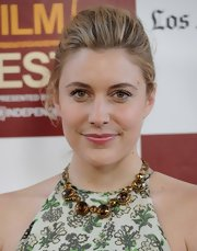 Greta Gerwig pulled her hair back in a French twist for a classic look during the premiere of 'To Rome with Love.'