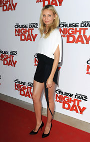 Cameron showed off her fabulous stems in a super short mini dress and pointed toe satin pumps.