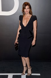 Gina Gershon put on a busty display in a deep-V LBD during the Tom Ford womenswear presentation.