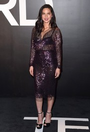Olivia Munn was all skin and sparkles in a see-through purple sequined top by Tom Ford during the label's womenswear presentation.