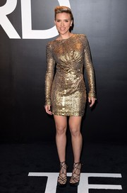 Scarlett Johansson brought the fierce factor to the Tom Ford presentation with this textured metallic-gold mini dress.