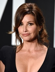 Gina Gershon came elegantly coiffed with this very loose chignon to the Tom Ford womenswear presentation.