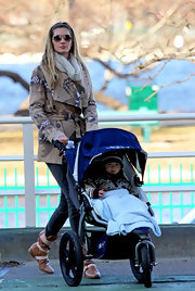 Giselle Bundchen took her son for a stroll in a tribal print trench and skinny jeans.