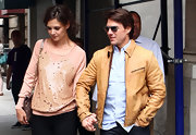 Tom looked casual-cool in a tan leather jacket with dark jeans and aviator shades.