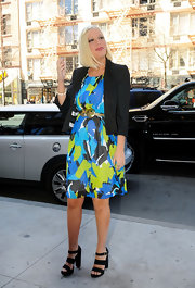 Tori Spelling went out in NYC wearing a vibrantly colored dress and strappy black sandals.