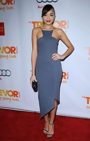 Ashley spiced up the red carpet in this artistic gray asymmetrical number.