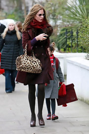 Trinny Woodall was retro-chic in a maroon wool coat as she took her daughter to school.