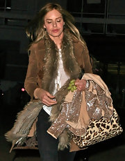 Trinny Woodall amped up the glam with a tan fur coat while out and about in North London.
