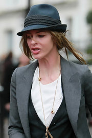 Trinny Woodall hid her disheveled 'do with a blue fedora as she went for a stroll.