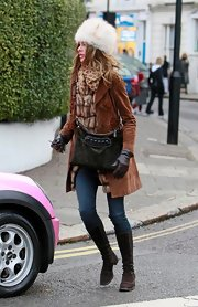 Trinny Woodall cozied up in a brown suede coat while on the school run.
