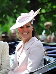 The Duchess wore this light pink decorative hat that featured a delicate bow detail to the Trooping the Colour 2013.