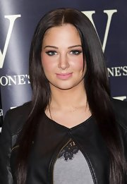 Tulisa's sleek strands were parted at the center and fell gracefully down her shoulders.