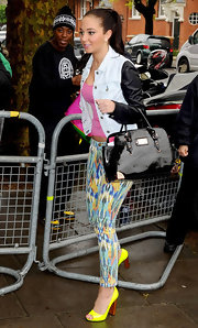 Tulisa Contostavlos was right on trend when spotted at BBC Studios in London, wearing a pair of neon yellow peep toe pumps.