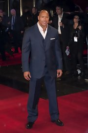 Dwayne Johnson still manages to show off his buff physique even in a polished suit!