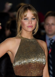 Jennifer Lawrence opted for a classic ponytail at 'The Hunger Games' European premiere. She softened the look by adding a few face-framing strands.