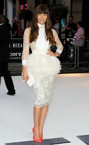 Jessica Biel matched her frilly outfit with a white Fendi leather clutch.