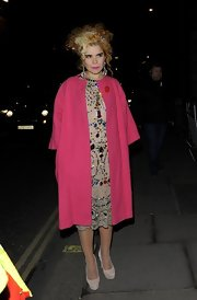 Paloma Faith is definitely not one to shy away from bright colors like this hot pink wool coat.